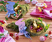 Bag of moss with chocolate bunny and chocolate eggs