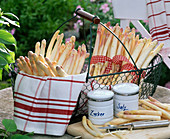 White asparagus (asparagus) in metal basket, kitchen towel