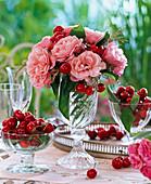 Bouquet of roses, prunus and grasses in glass beaker, peel