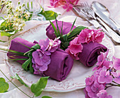 Hydranga (hydrangea), blossoms threaded to napkin rings