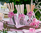 Hydrangea, flowers on glasses with white cutlery on tray