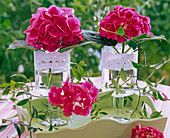 Hydrangea in glasses with cake topping on tray