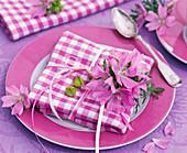 Malva moschata blossoms on checkered napkin