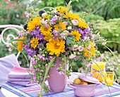 Bouquet of heliopsis (sun's eye), malva (musk mallow), phlox