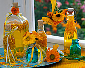 Petals of calendula in bottles with oil, flowers,