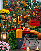 Autumnal evening terrace with lantern and candles