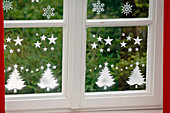 Window decoration with snow spray and stencil