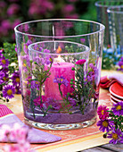 Lantern filled with aster and purple decorative sand