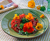 Salad with edible flowers, Tropaeolum, Origanum