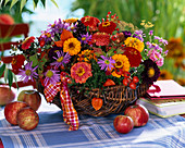 Arrangement made of Zinnia, aster (autumn shade), callistephus