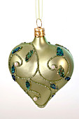 Green heart with tendrils as Christmas tree decoration, cut out