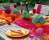 Table decoration with Echeveria, table runner in orange and pink