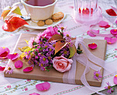 Book Present with Bouquet of Aster (Herbstaster), Rosa (Rose)
