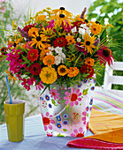 Late summer bouquet in colorful bag