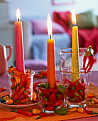 Capsicum in small glasses as a candle holder