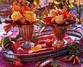 Small bouquets of Rose, capsicum, autumn leaves