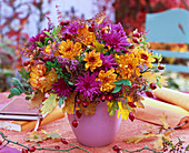 Autumn chrysanthemums and oak leaves bouquet