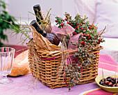 Basket of pernettya (peat myrtle), wine bottles, decorated