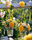 Small bouquets of roses, leucanthemum, antirrhinum