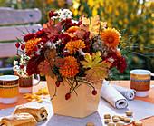 Bouquet of dahlia, chrysanthemum, autumn leaves