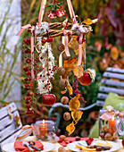 Wreath with hanging rosehips, Clematis seeds, Juglans