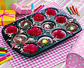 Muffin tin backing form filled with Dahlia flowers, small wreaths