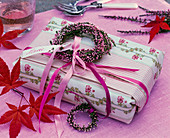 Book gift wrapped in cloth with garland from Calluna