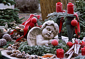 Angel in wreath of Abies, Buxus, candle holder with Pinus