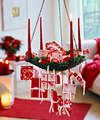 Hanging Christmas wreath with red and white parcel