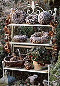 Wreaths and balls with larix cones, star anise, basket with pinus