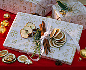 Gift with citrus (lime slices), cinnamon sticks