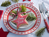 Gingerbread star with frosting and sweets 'Frohes Fest'