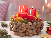 Floral foam in bowls with Juglans pinned as Advent wreath