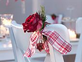 Rose (red rose), tip of pseudotsuga (douglas fir) and glass star