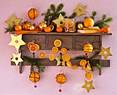 Shelf with citrus (orange), orange slices, stars, balls