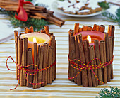 Candles with cinnamon sticks cased