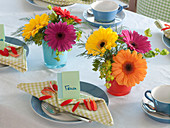 Cheerful colorful gerbera table decoration