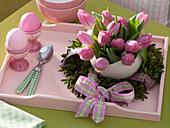 Tulipa (tulip) in ostrich egg in Buxus (Box) wreath