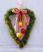 Moss heart on door