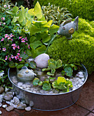 Small water feature, zinc bowl with ceramic fish, gravel