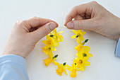Napkin rings out of narcissus flowers
