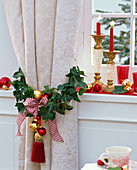 Hedera (ivy) decorated around curtain Christmassy, candle holder