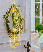Door wreath in egg shape with Salix, Hedera, Cytisus
