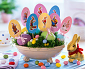 Easter nest with Sagina, Easter eggs, paper eggs with wafer hare