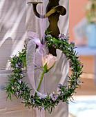 Wreath of rosmarinus branches on doorknob, Rosa