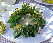 Napkin decoration with a small Mentha and Origanum wreath