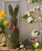 Easter decoration on the terrace with Easter straw bunnies, Easter basket, Narcissus