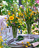 Meadow bouquets from Taraxacum, Ranunculus, Rumex