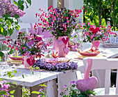 Table decoration with bouquets of Dicentra, Myosotis