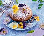 Sugared Viola cornuta (horn violet) flowers on muffin